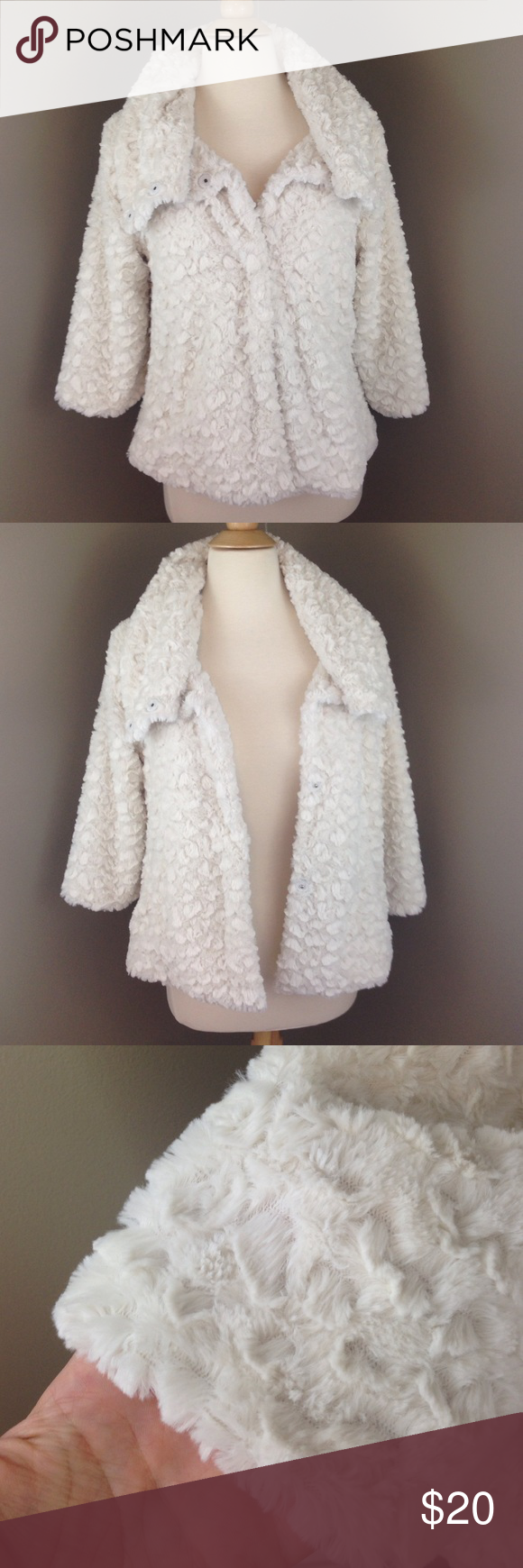 Soft Cream Jacket This is an adorable little jacket and it's so soft/comfy. It has 3/4 sleeves with pockets. Collar has several buttons and can be worn different ways. Never worn. I just have too many jackets. Actual size says S/M. unknown Jackets & Coats