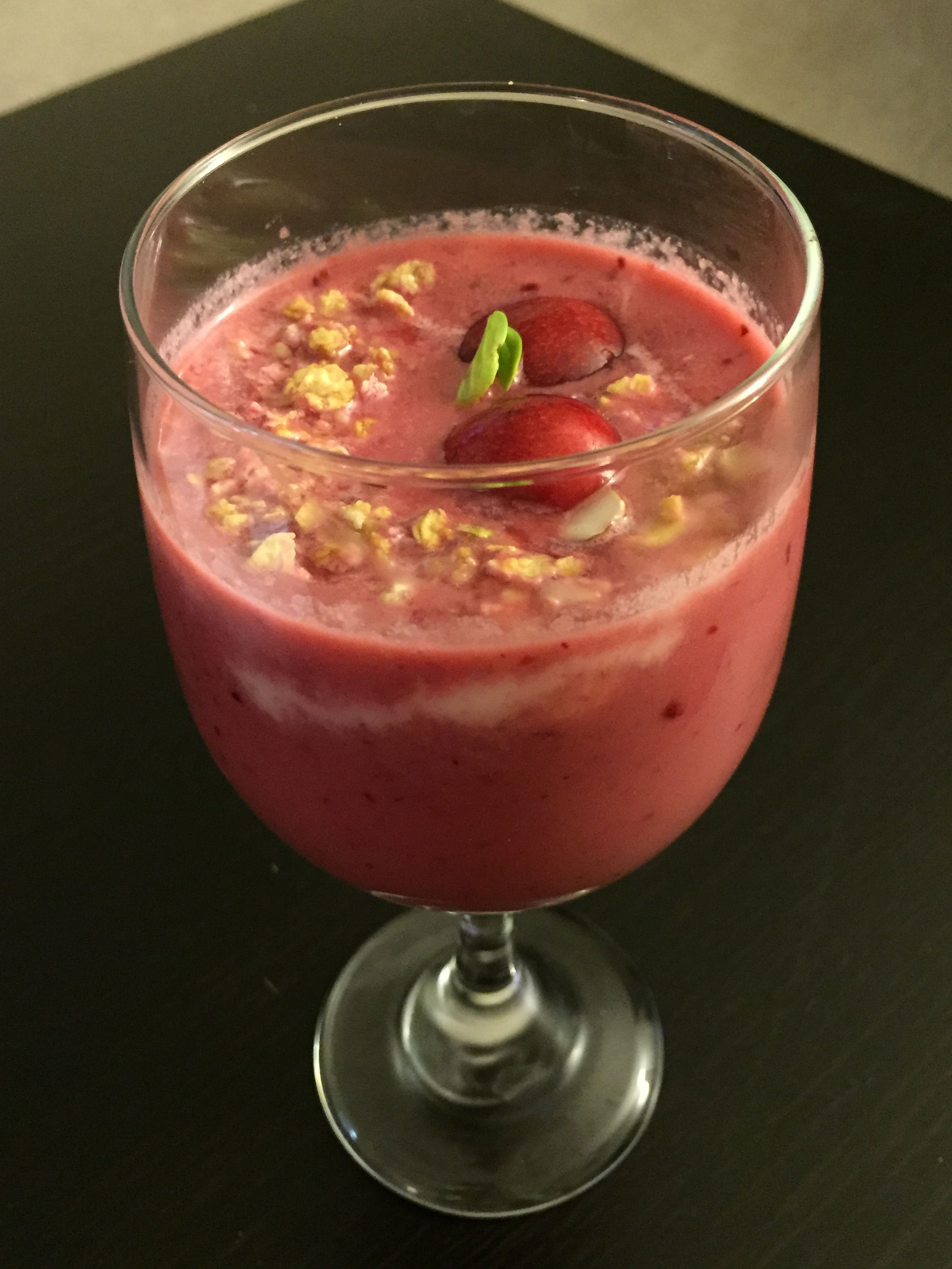 Cherry smoothie with yogurt and granola