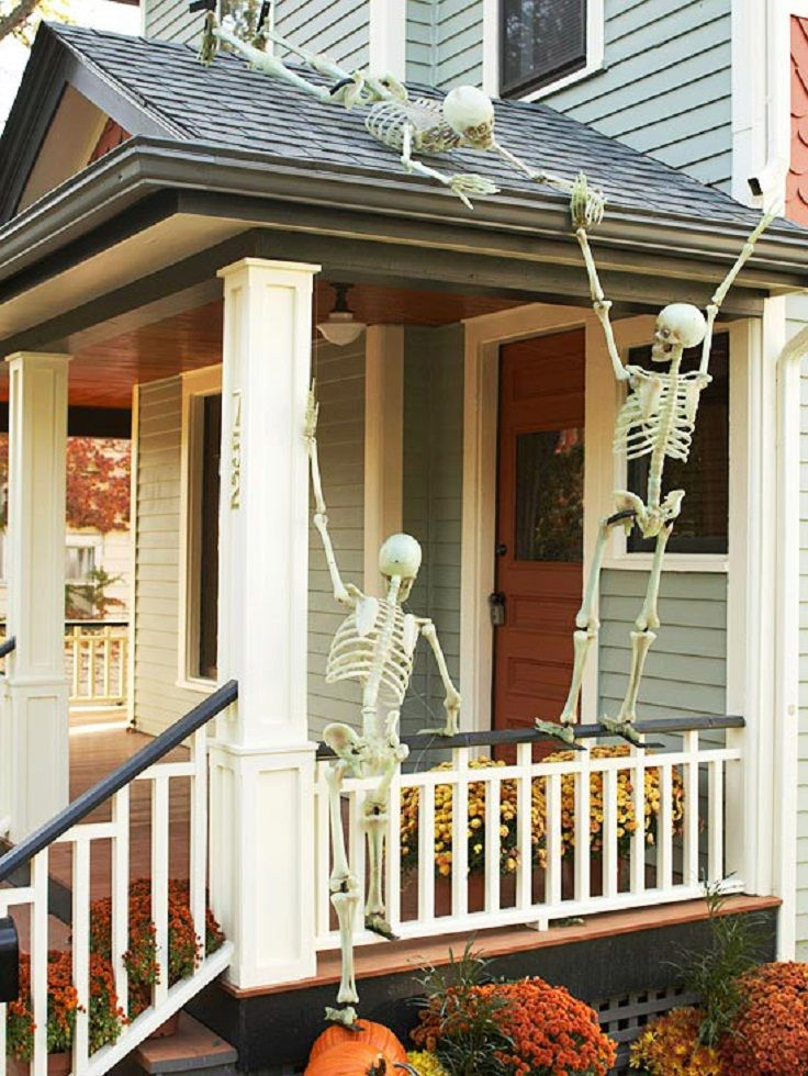 Halloween Porch Decor with Rooftop Skeletons - 13 DIY Fall Porch - outdoor halloween ideas