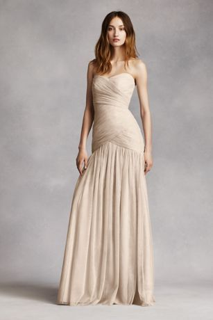 Trendy Strapless pleated bodice with ultra feminine sweetheart neckline Drop waist flare skirt gives this gown an ethereal feel Sizes Fully lined Dry clean