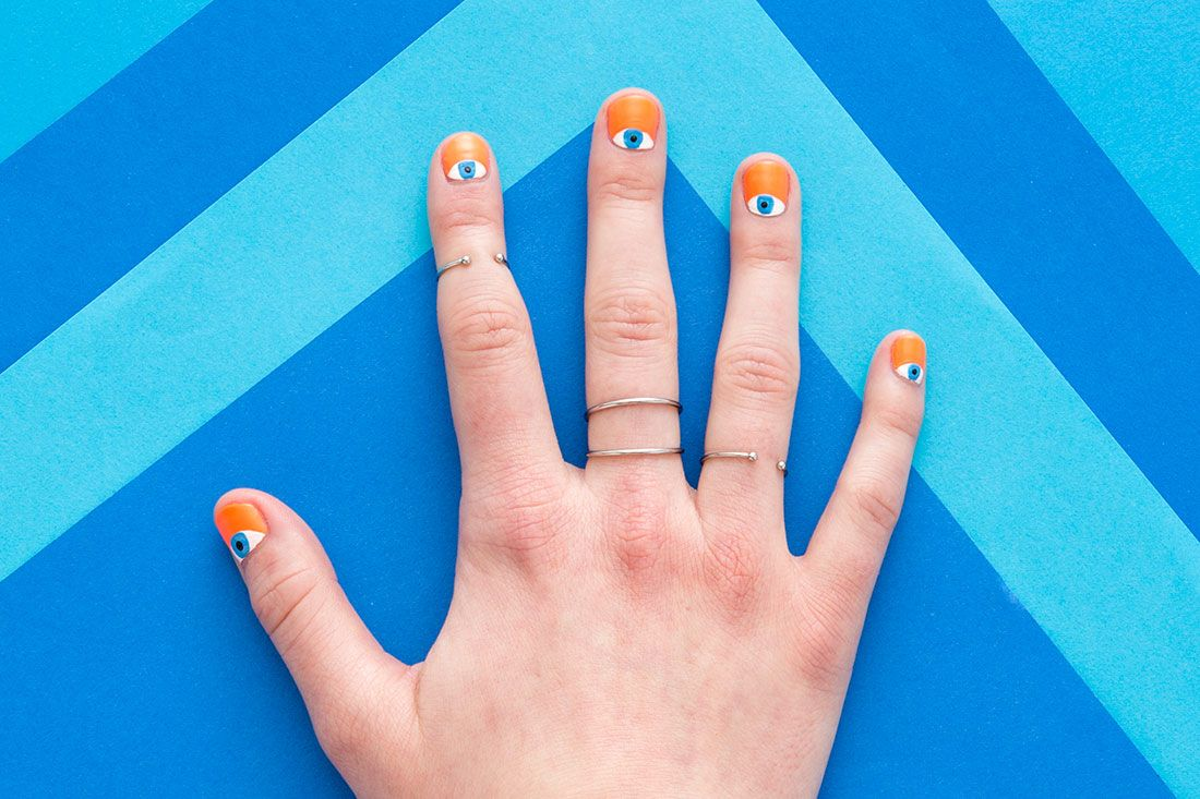 These DIY Evil Eye Nails Take Half Moon Manis to the Next Level via Brit + Co.