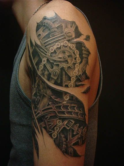 87c444120be75 SteamPunk Machine Arm Tattoo - First time I've seen a chain incorporated  and it looks amazing
