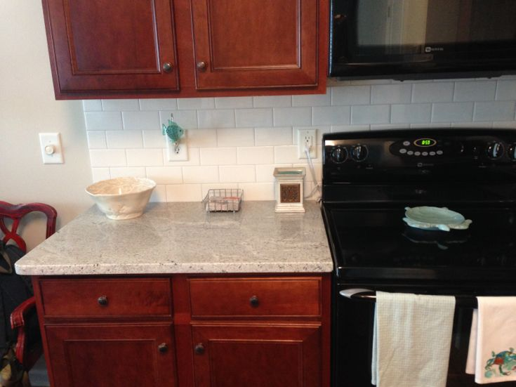 Best light granite for traditional cherry cabinets