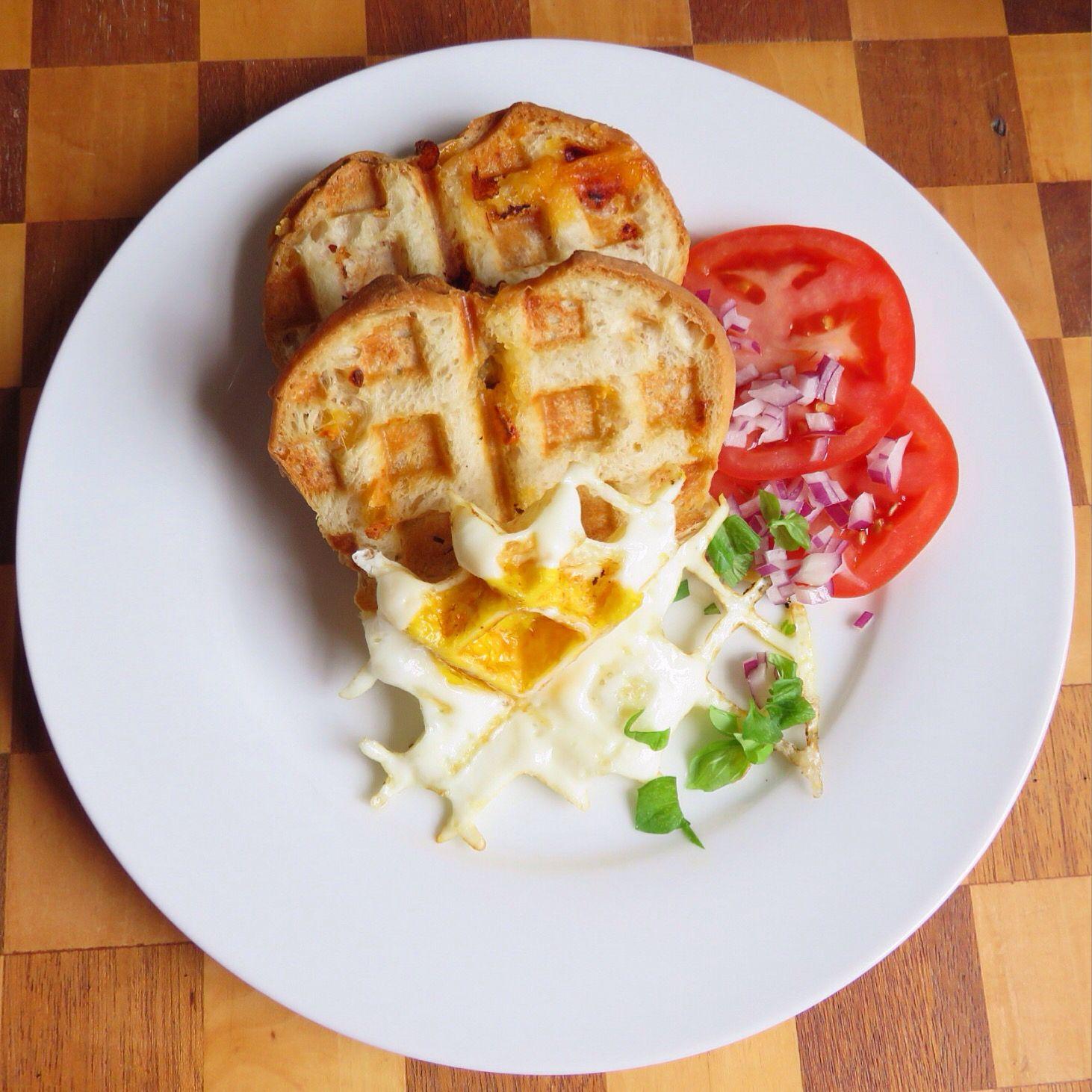 "2/8/16 grilled Italian cheese sandwich.  실험작;) 구운 치즈 샌드위치. *빵사이에 체다치즈, 몬저넬라치즈, 토마토, 붉은양파, 바질, 오리가노, 페페론치노넣어 오리브오일 겉에다 살짝발라 와폴기계에다 눌러 주세용~  계란을 너무 익혔다 그러나 재미있는 모양, 된장>.<"" 다음에 다시 도전."