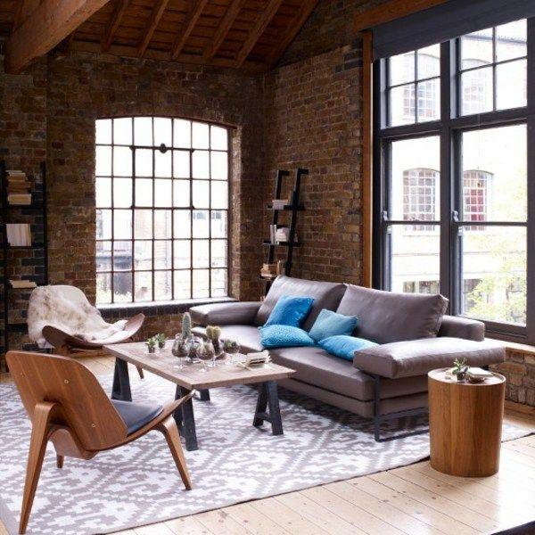 modernes Wohnzimmer einrichten braun lila Holz Möbel Natursteinwand ...