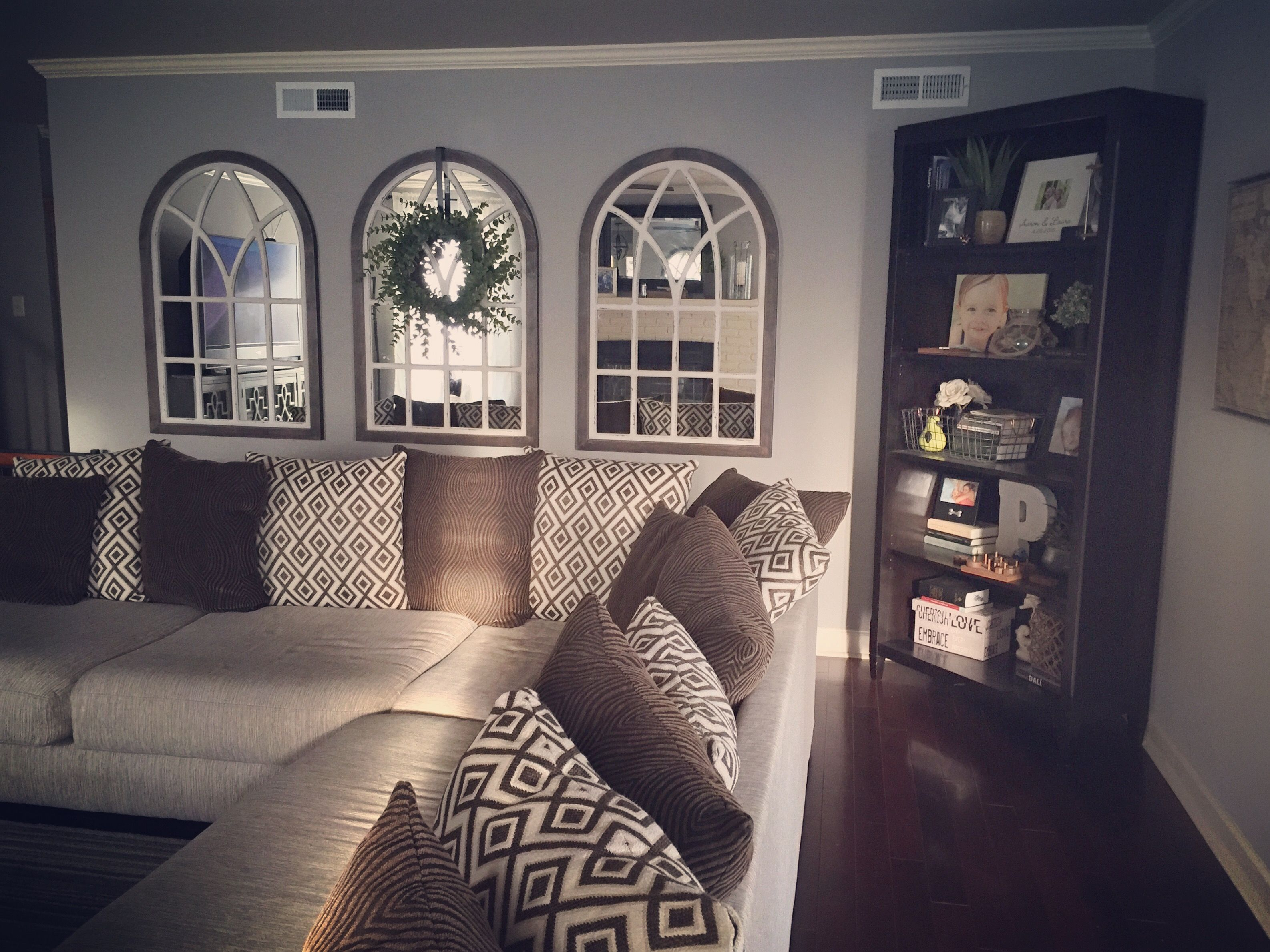 Arched Mirrors And Succulent Wreath Farmhouse Style I Don T Like Our Couch But It S Huge And We Have Farm House Living Room Living Room Remodel Couch Decor