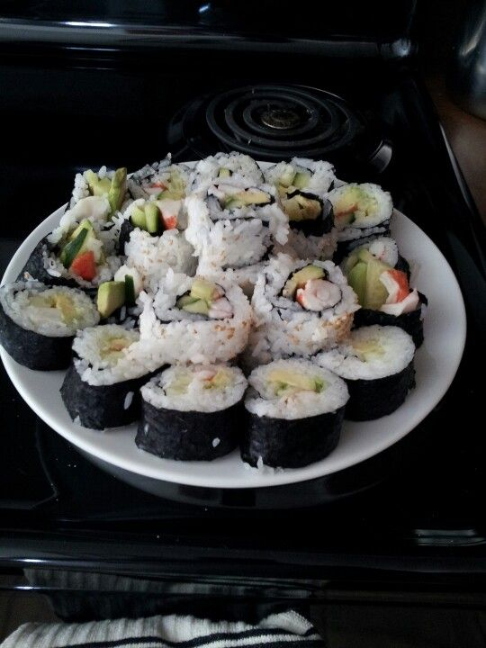 Homemade sushi.  The key is the rice.  Two tablespoons of rice vineager for every tablespoon of suger.  If you want to roll it inside out use a piece of wax paper on your sushi roller to prevent it from sticking