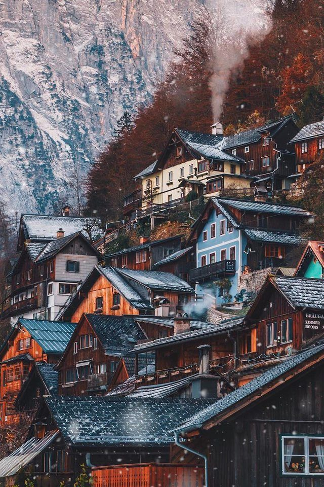 The village of Hallstatt, Austria looks very warm and cozy nestled among the pines.
