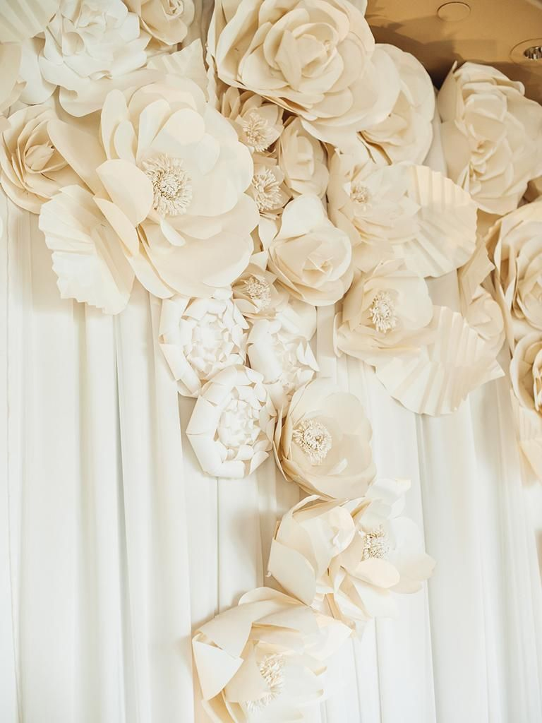 Wedding decorations paper flowers  White paper flower background for a glamorous wedding reception