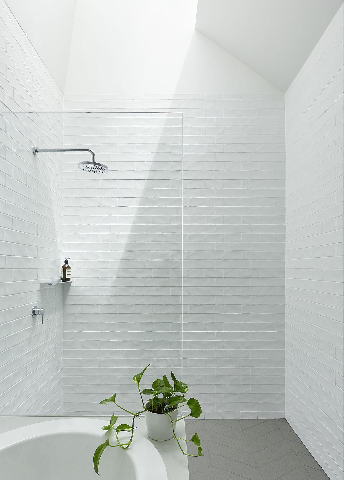 White Textured Tiles For The Bathroom With Skylight Bathroomdesignwellingtonnewzealand Modern Bathroom Design Small Bathroom Remodel Modern Bathroom