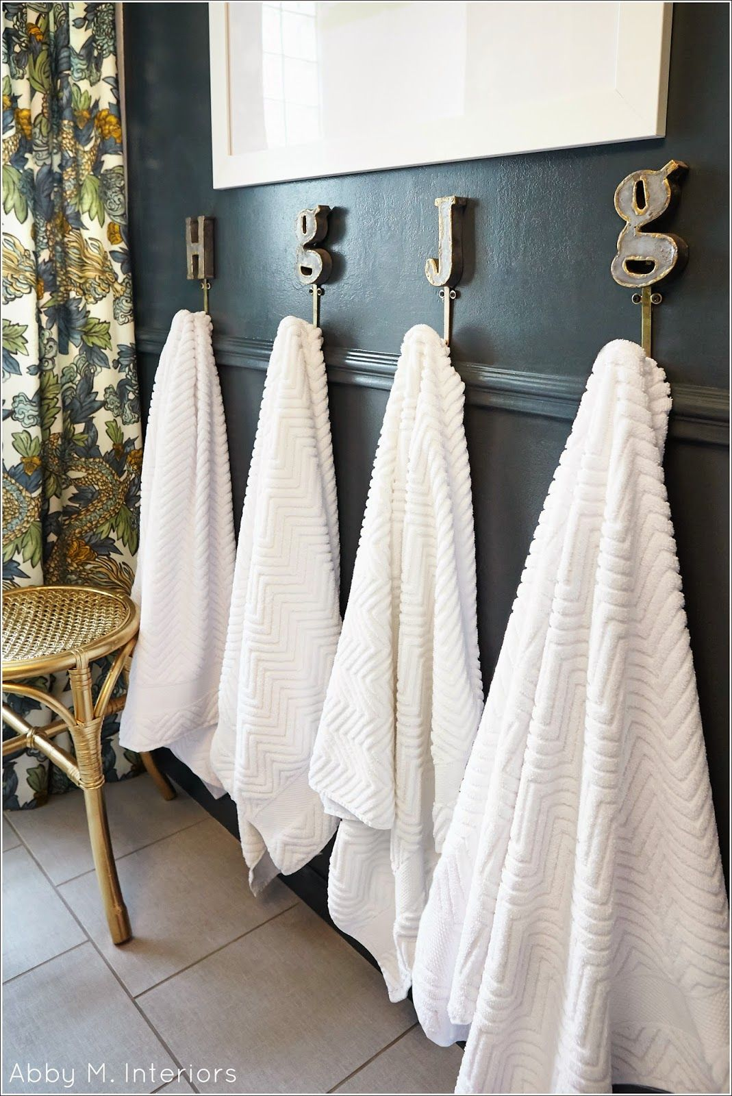 Initial hooks for busy kid bathrooms. Abby M. Interiors: