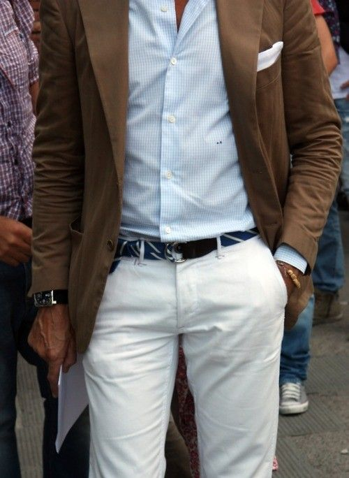 White trousers. Brown jacket. Canvas belt. Beads.