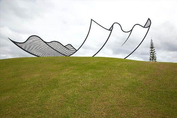 """Neil Dawson's """"Horizons"""" optical illusion sculpture is installed on """"The Farm,""""a large private art park in New Zealand. Dawson's work often uses illusion and such optical patterns as moiré to achieve their effects."""