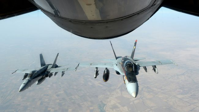 US warplanes have killed at least 22 civilians and injured 43 others in Iraq, reports say.  ARTICLE: