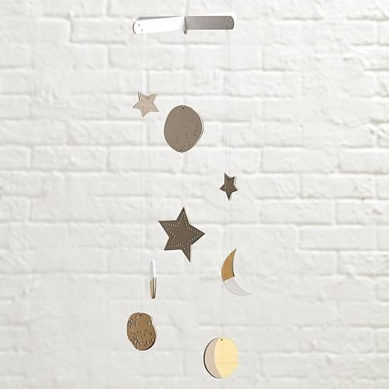 Shop Celestial Mobile.  You can bring the starry night sky indoors thanks to our Celestial Mobile.  Designed exclusively by Lotta Jansdotter, each moon and star is completely unique due to the intricate laser-cut process.