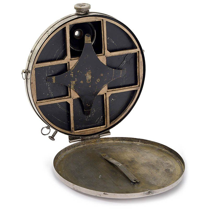"""C.P. Stirn's Photographische Geheim-Camera, c. 1886 Stirn, Berlin. Rare model for 4 exposures, plate size 1 ½ x 1 ½ in. (43 x 43 mm), body no. 12425, engraved on back """"C.P. Stirn's Photographische Camera"""", diameter of the body 6 in., rotating shutter (stuck), black-painted brass lens, body in excellent condition"""
