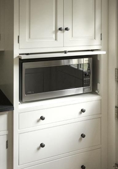 11 Strategies For Hiding The Microwave Remodelista Built In Microwave Cabinet Microwave In Kitchen Clutter Free Kitchen