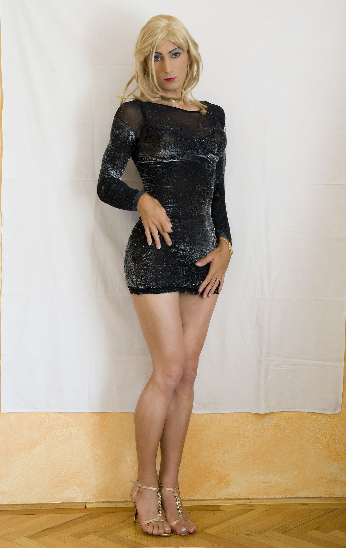Beautiful shemale in a short dress gives you a great upskirt of her cock and ass
