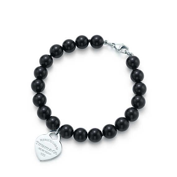 Return to Tiffany mini heart tag in silver on a black onyx bead bracelet Tiffany & Co. IXO5O3Jj