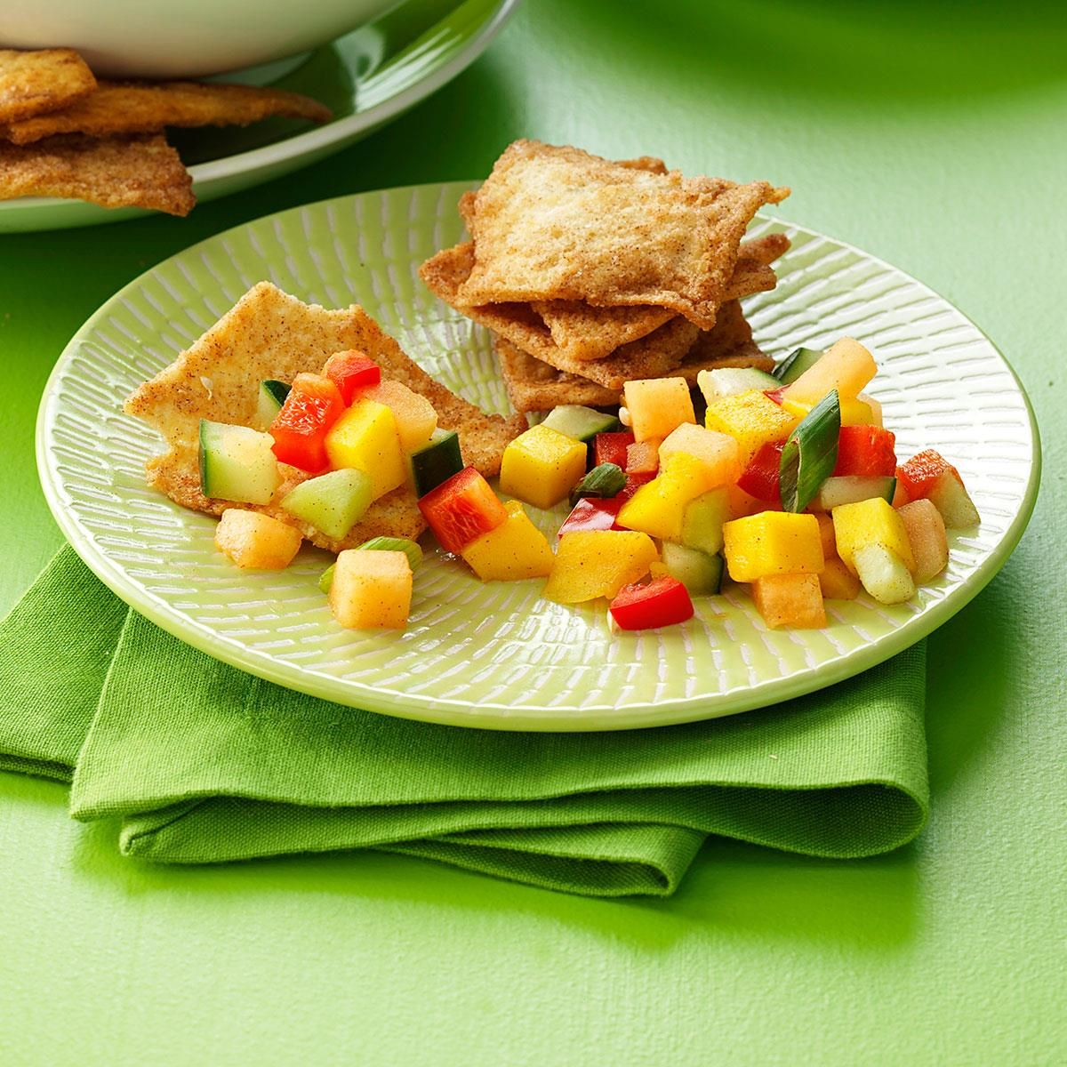 """Melon-Mango Salsa Recipe -""""After tasting a similar salsa on top of fresh fish at a fishing tournament, I went home and tried to duplicate it. This is my surprising result! It's terrific with cinnamon pita chips."""" —Sylvia Fincham, New Bern, North Carolina"""
