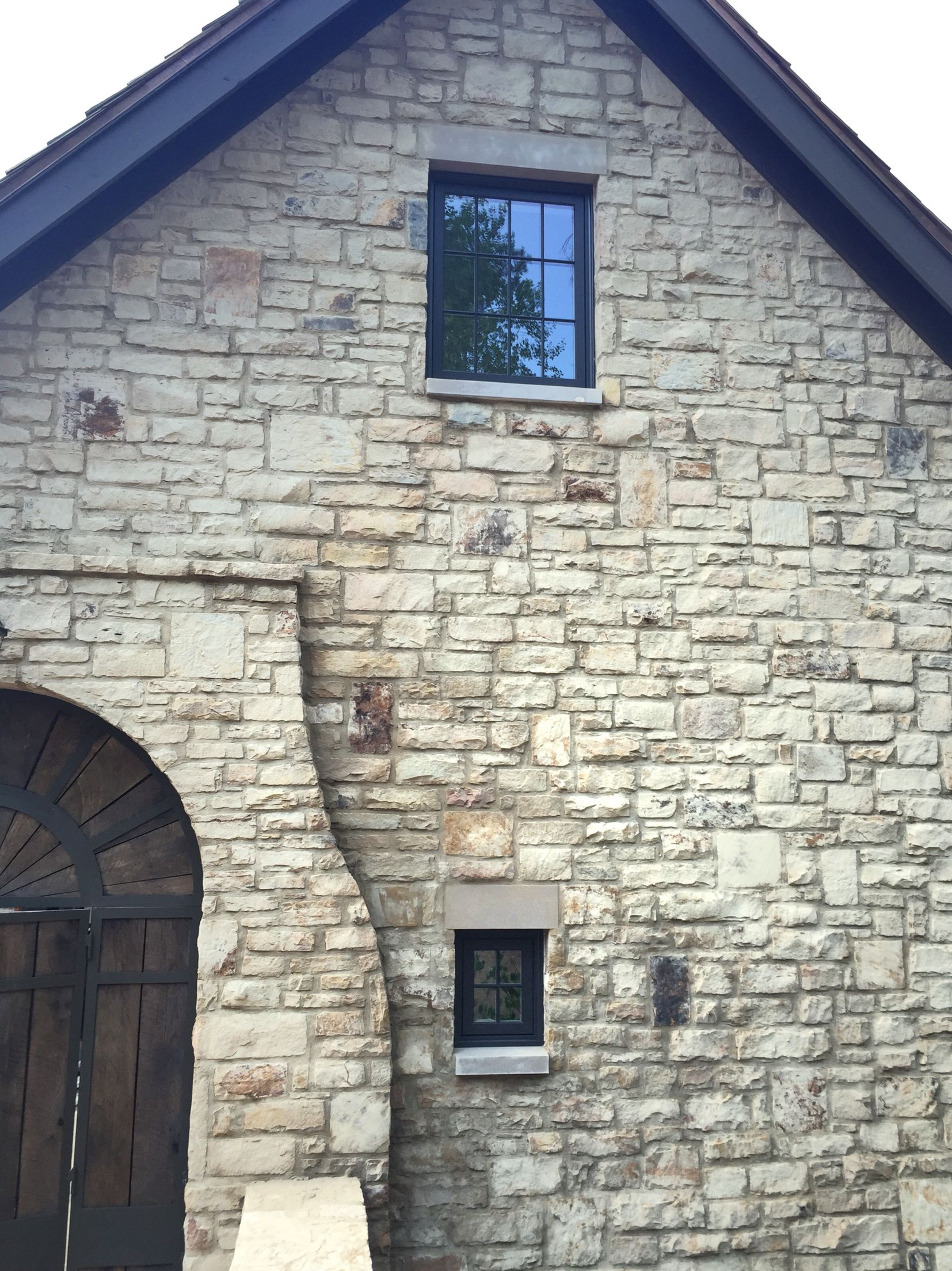 Lime wash on stone exterior by struttura for American brick and stone