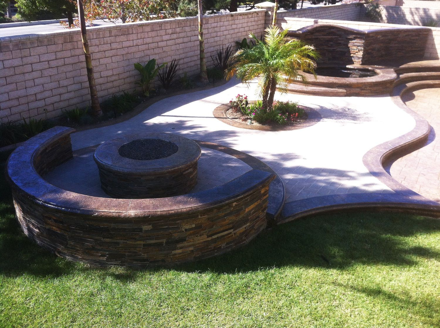 Spa; Waterfall; Stamped concrete; pavers; planter; Fire ...