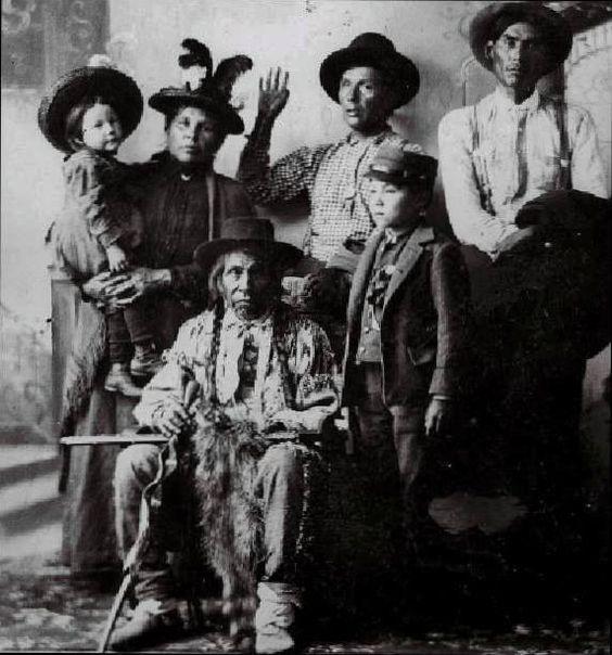 Shaynowishkung (aka One Who Makes A Jingling Sound, aka Bemidjigamaug, aka Lake Through Which A River Flows, aka Chief Bemidji), with his children and grandchildren - Ojibwa - 1900: