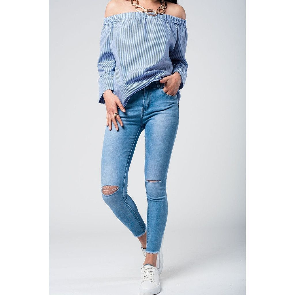 011c1827381d0 Light wash jeans with broken knees and fringe on the bottom ...