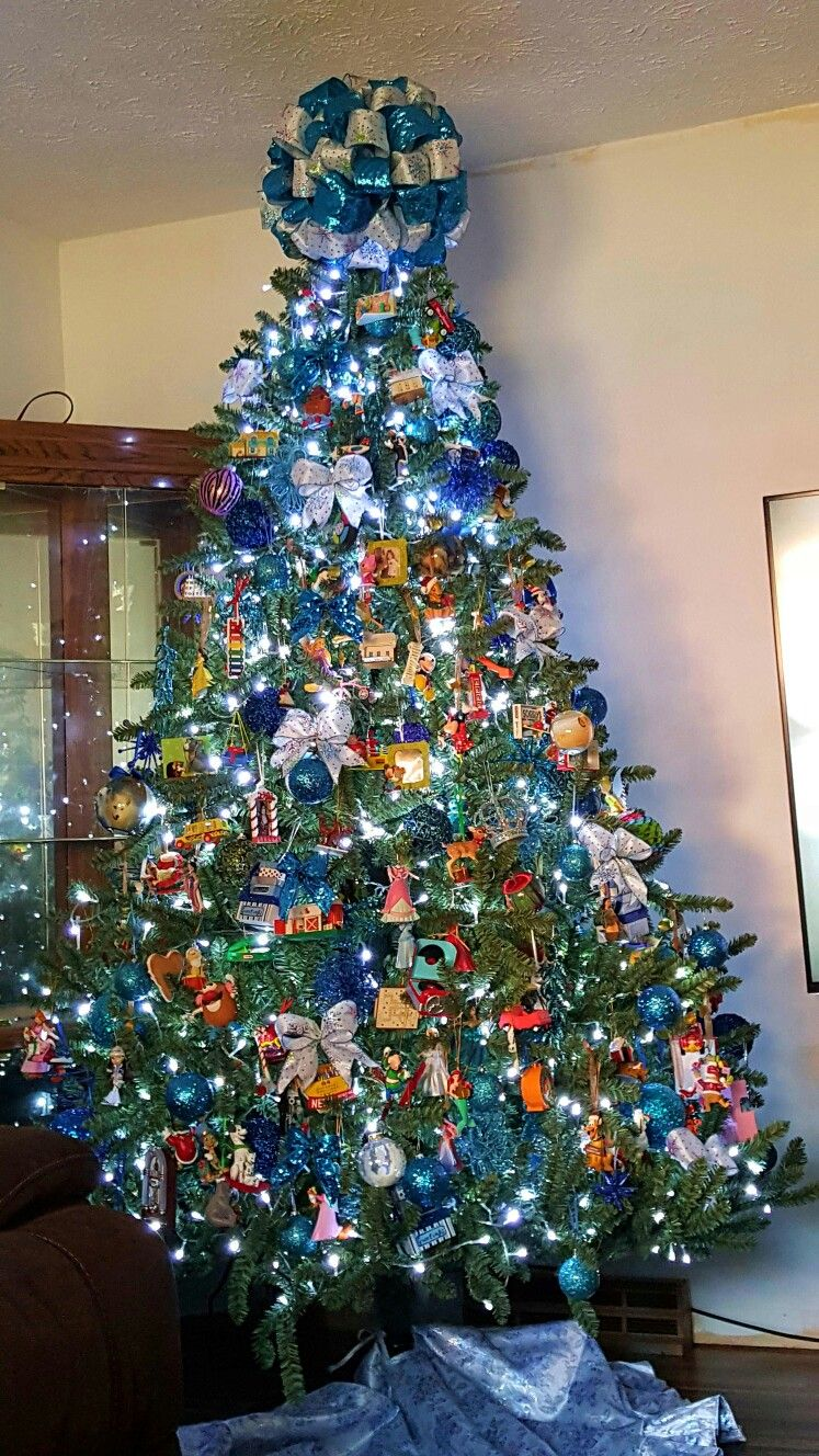 Enjoyable Turquoise Blue And Silver Tree Adorned With Disney And Download Free Architecture Designs Scobabritishbridgeorg