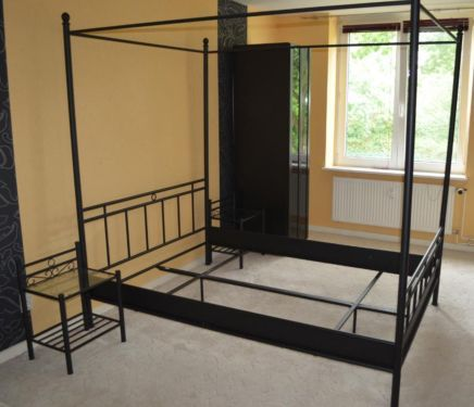 Metal fourposter bed for sale with two bedside tables