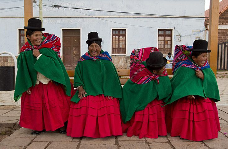 Tiwanaku, Bolivia: Bolivian indigenous women joke during commemorations for the second year of President Evo Morales's government