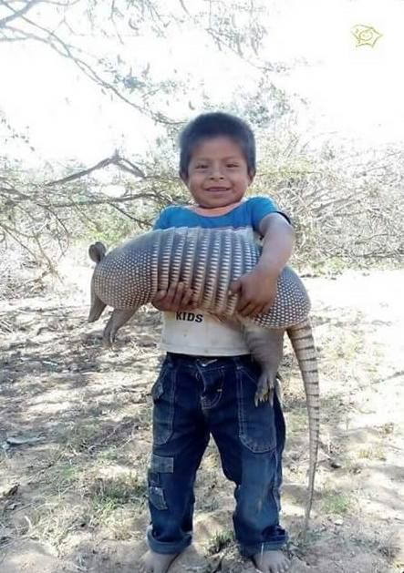 This little guy with his pet armadillo. In northern Argentina the indigenous kids raise them as pets. They forage all day, but come home to sleep every night and are very tame.