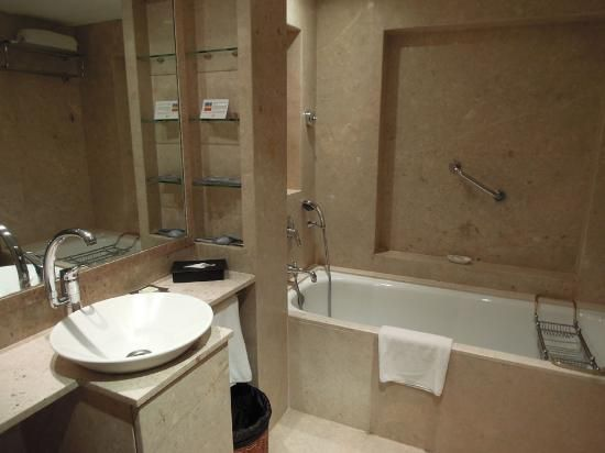 The LaLiT Mumbai: A Standard Bathroom  Regular Marble Interiors, Pastel  Neutral Shades And