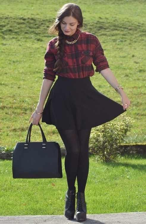 e496ecc37d black skater skirt with a red and black plaid shirt with gold chains and  black leggings