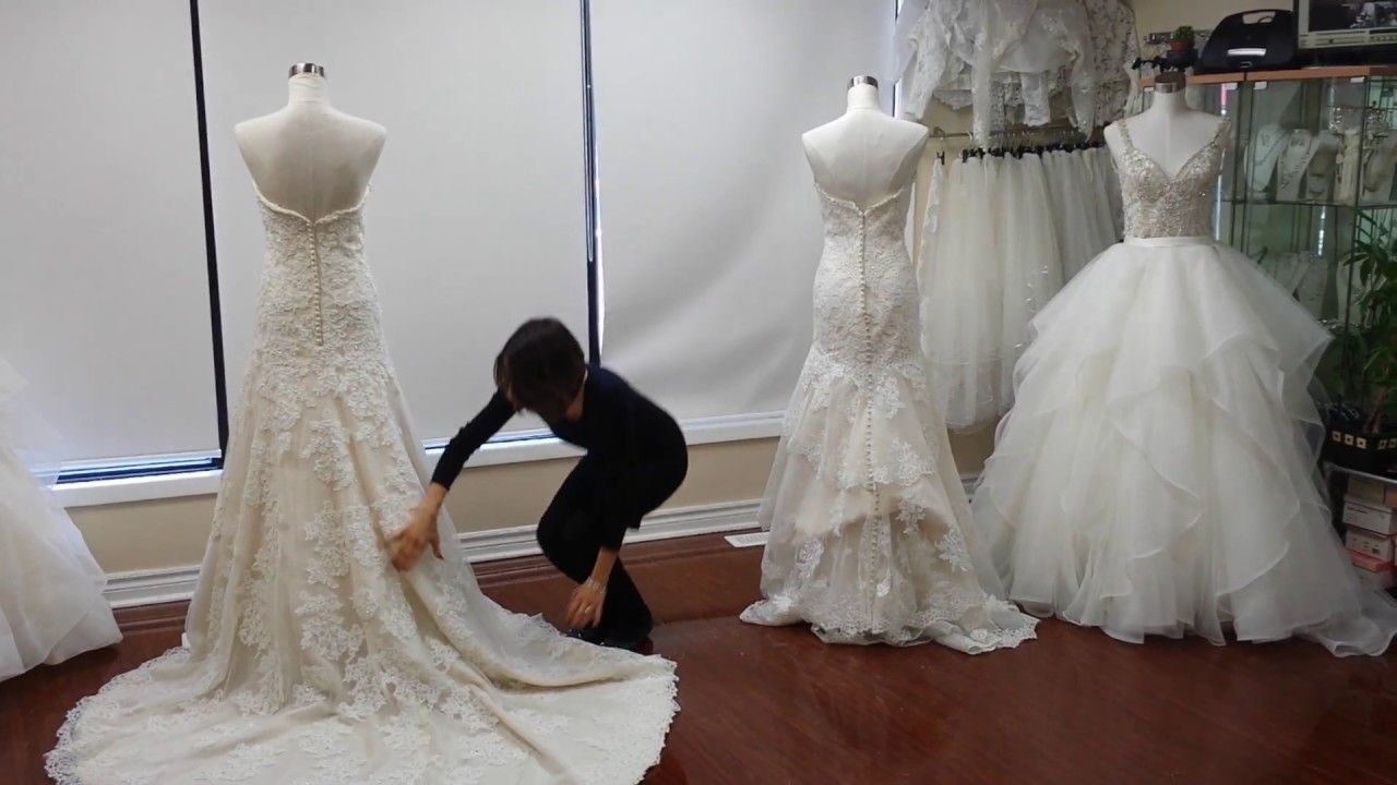 How to bustle your wedding dress french bustle vs american for Wedding dress train bustle