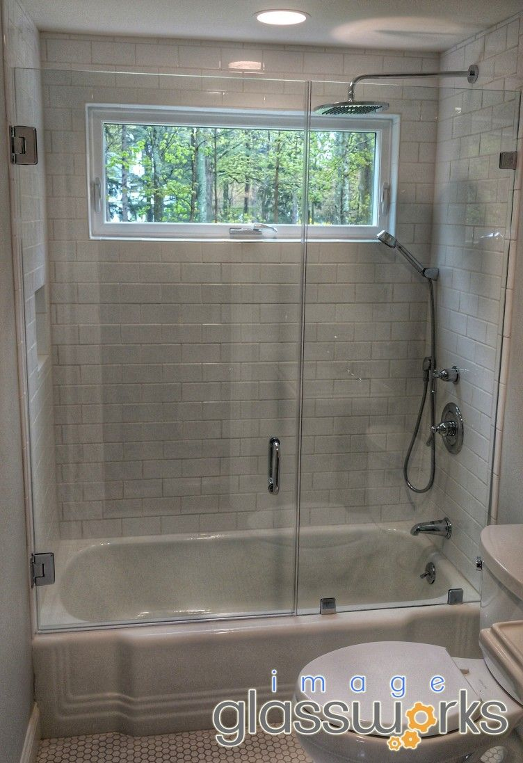 Beautiful Swinging Door And Panel Mounted On Top Of A Tub With