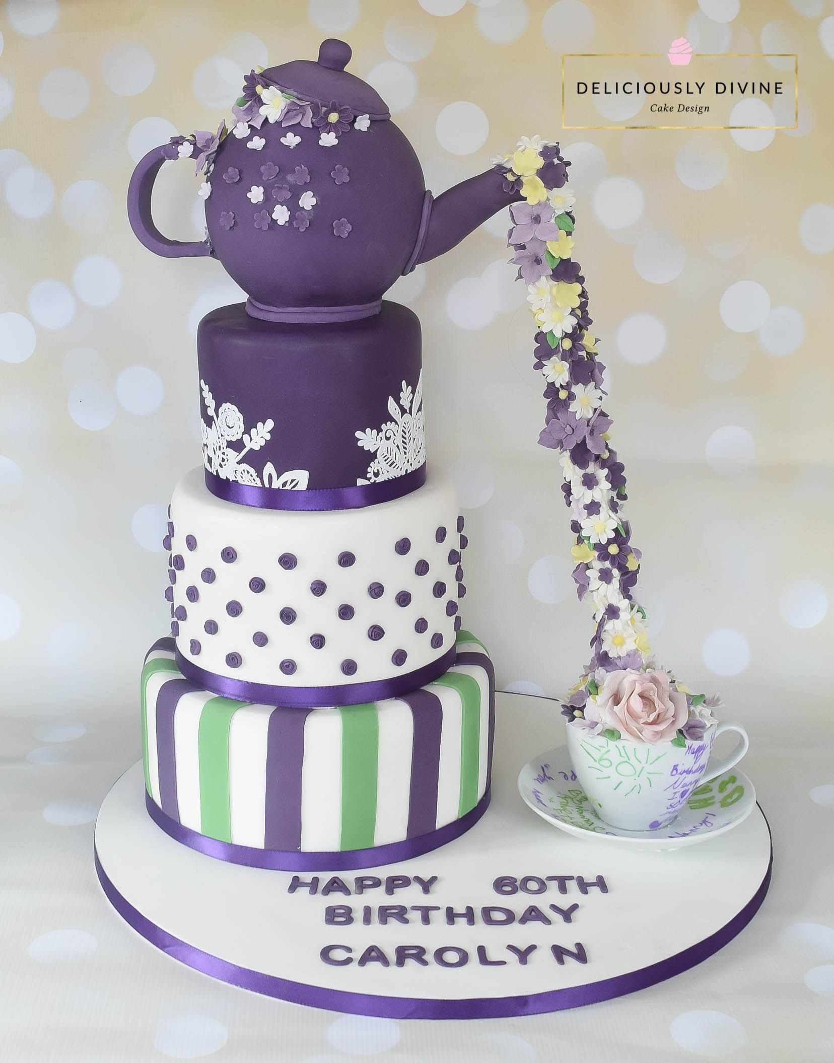 A teapot with during flowers 3 tier birthday cake. Purple