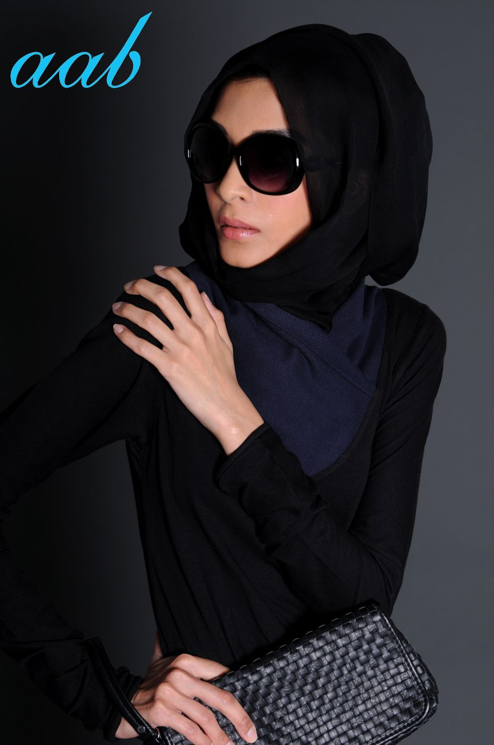BLACK NAVY ABAYA  If your going for silhouette this season then pick Black Navy, stylish high neck wrap over in navy blue and main body in black jersey which simply drapes beautifully down. It's a no nonsense item that simply oozes style.  http://www.aabcollection.com/shop/product/black-navy-abaya/131