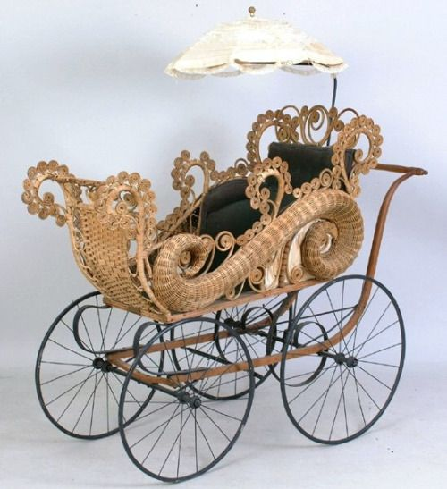 Ornate late Victorian wicker buggy.