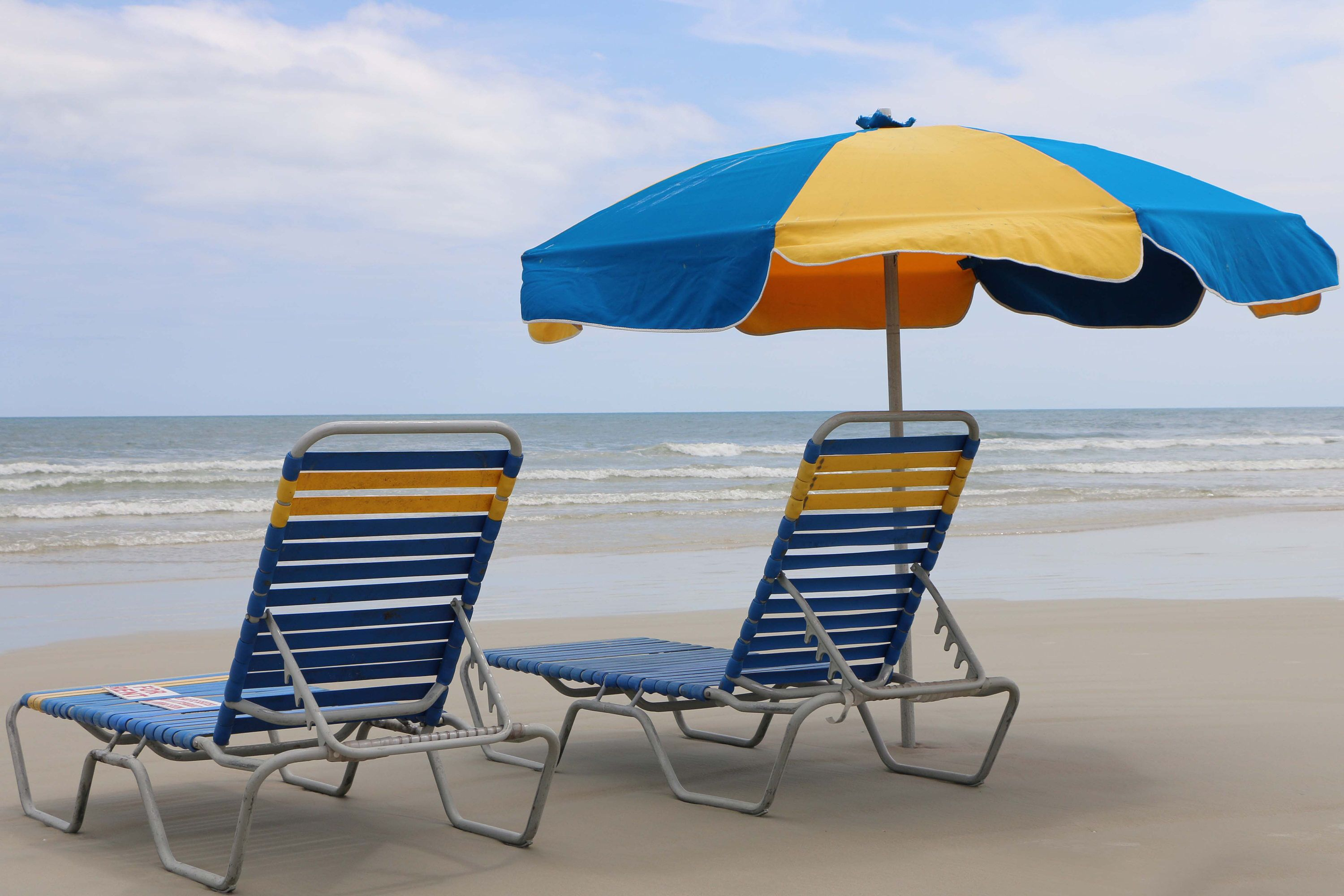 Beach Chairs And Umbrella Overlooking
