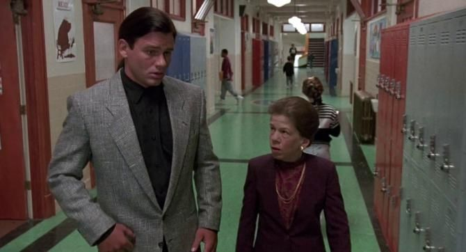 Linda Hunt and Richard Tyson in Kindergarten Cop (1990