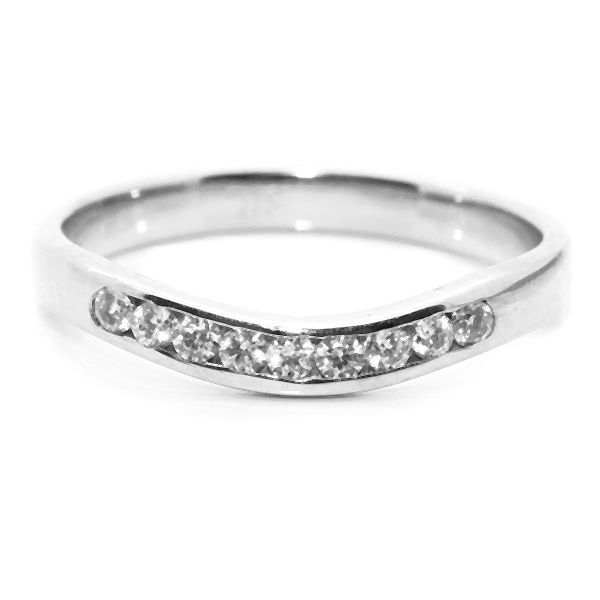 Fabulous Curved diamond set wedding ring to acmodate slight setting Channel set diamonds to accent the