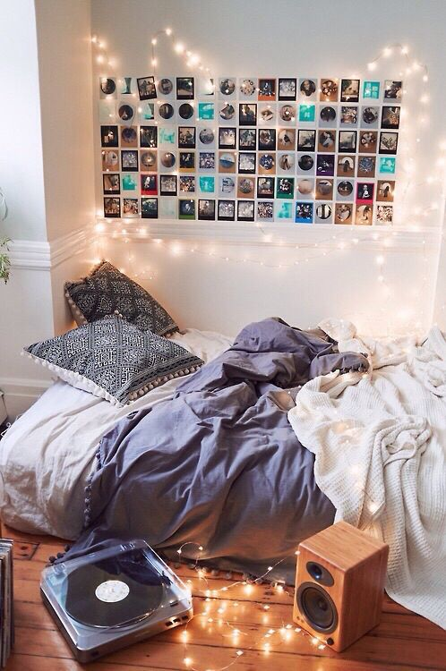 Bedroom With Fairy Lights And Wall Of Pictures