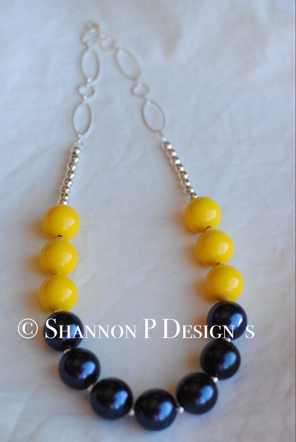A personal favorite from my Etsy shop https://www.etsy.com/listing/253685945/dark-yellow-and-navy-blue-chunky-beaded