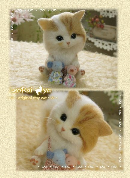 Needle felted kitten with tiny toy elephant and pig by LeoRai*ya from Japan.  Adorable!
