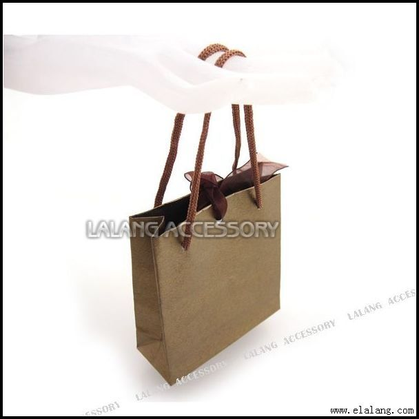 How to tie a ribbon around a gift bag with handles. For the goodie bags