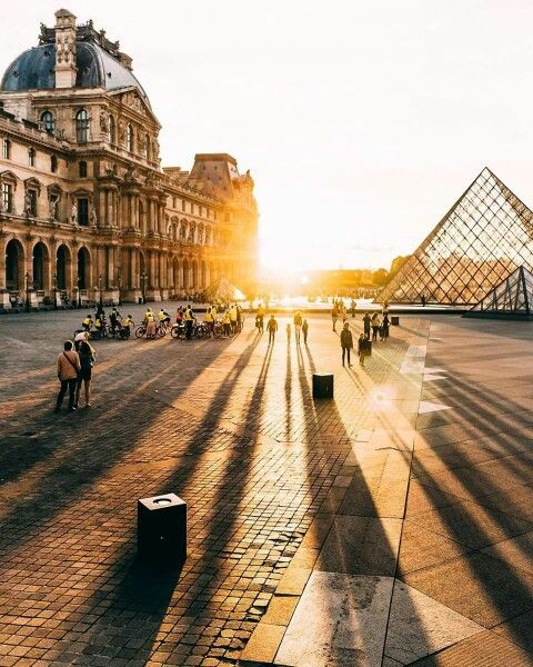 Morning light Paris Art symphony. Check out the glass pyramid! It's one of many places to see in Paris. I love Paris.