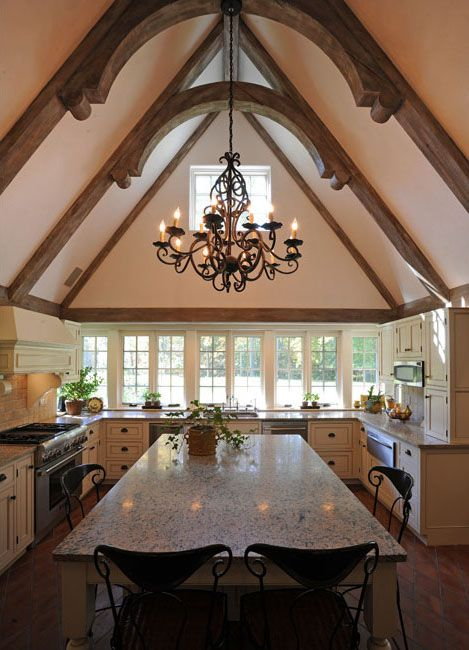 vaulted ceiling with wooden beams and curved trusses kitchen with cream cabinets and a wall on kitchen cabinets vaulted ceiling id=71045