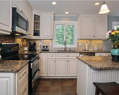antique white kitchen cabinets with black appliances, White cabinets, black appliances and tan counter