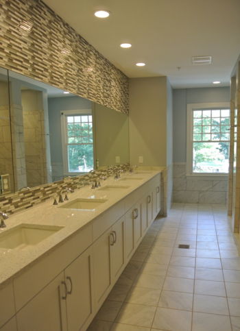 Gorgeous sorority bathroom remodel in Chapel Hill, NC. Designed by